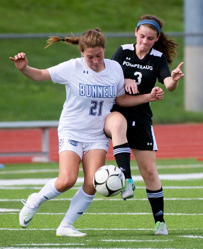 Bunnell's Mia DiPronio (21) and Pomperaug's Lauren Neisser (21) battle for the ball during their game Saturday at Pomperaug High School. Jim Shannon Republican American