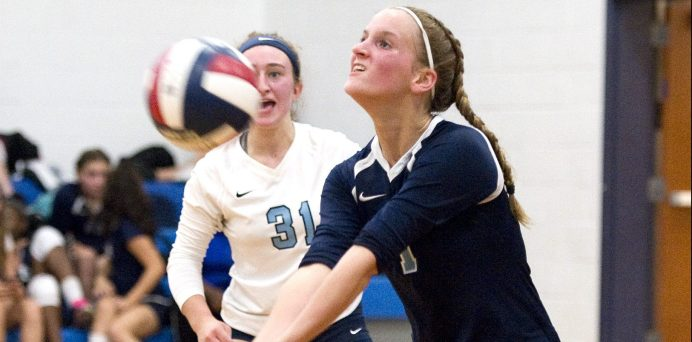 Oxford's Olivia Lombardi (1) bulbs a serve as teammate Aniela Olbrys (31) looks on during their match against Seymour Tuesday at Seymour High School. Jim Shannon Republican American