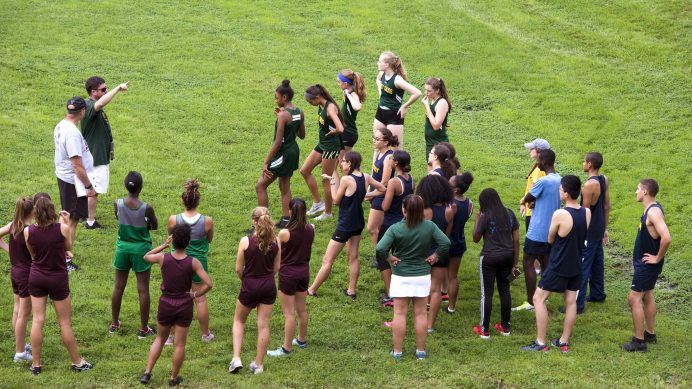 Runners and coaches from Holy Cross, Torrington, Kennedy and Wilby, get course instructions prior to their meet Wednesday at Holy Cross High School in Waterbury. Jim Shannon Republican American