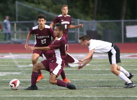 Naugatuck High School's Bruno Silva tries to get past Woodland High School's Dante Polletta in front of teammate Nelson Lavoura (27) during the boys varsity soccer game in Naugatuck on Thursday. Emily J. Reynolds. Republican-American