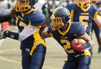 Kennedy's Elijah Nelson (2) runs for a first down behind the blocking of teammate Marquise Blagmon (13) during their game against Kennedy Saturday at Municipal Stadium in Waterbury. Jim Shannon Republican American