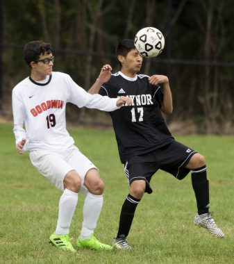 Kaynor Tech's Jordy Avendano (17) heads the ball after getting position in front of Goodwin Tech's Chris Cumba (19) during their game Monday at Kaynor Tech High School in Waterbury. Jim Shannon Republican American