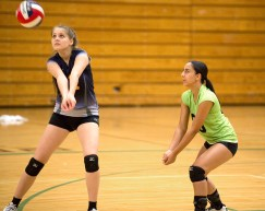 Kennedy's Tesi Tili (12) gets under the ball as teammate Ariana Padilla (00) looks on during their NVL volleyball game against Wilby Tuesday at Wilby High School in Waterbury. Jim Shannon Republican American