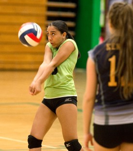 Kennedy's Ariana Padilla (00) bumps the ball during their NVL volleyball game against Wilby Tuesday at Wilby High School in Waterbury. Jim Shannon Republican American