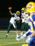 Holy Cross High School quarterback Corey Fappiano fires a pass up the field during the varsity football game in Seymour against Seymour High School on Friday. Emily J. Reynolds. Republican-American
