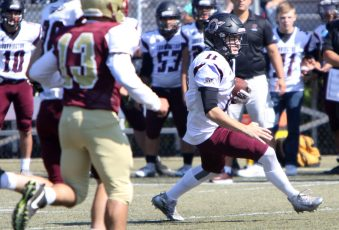 QB #11 Ora Curry of Torrington rushes for yardage against Sacred Heart/Kaynor during 2nd quarter NVL football action at Municipal Stadium in Waterbury Saturday. Steven Valenti Republican-American