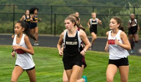 Runners take to the course during their cross country meet with Derby, Kennedy, Sacred Heart and Woodland Tuesday at Woodland Regional High School in Beacon Falls. Jim Shannon Republican American