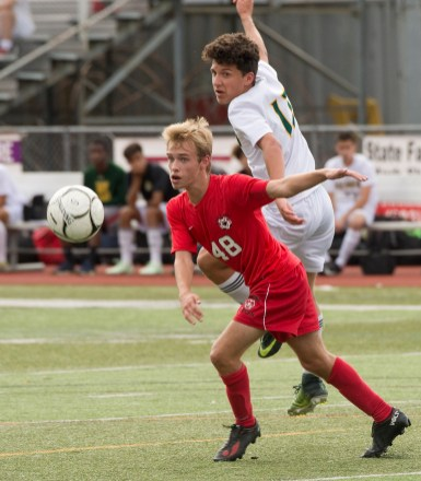 - Cheshire's Francis Fritz (48) and Hamden's Joshua Venditto (17) battle for the ball during their game Wednesday at Cheshire High School. Jim Shannon Republican American