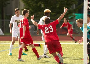 Cheshire's Matthew Mayano (23) celebrates with his teammates after Evan Esposito (21) scored a first-half goal during their game against Hamden Wednesday at Cheshire High School. Jim Shannon Republican American