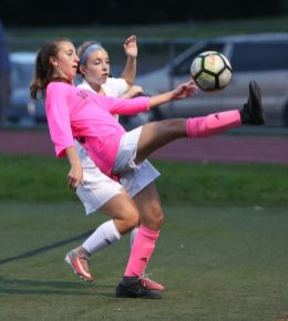 Wolcott High School's Brooke Tracey battles Seymour High School's Amanda Backus for the ball during the girls varsity soccer game in Wolcott on Thursday. Emily J. Reynolds. Republican-American
