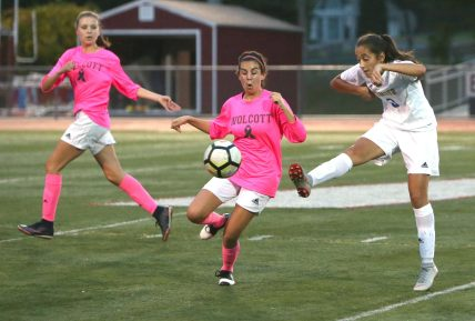 Wolcott High School's Samantha Riviezzo knocks the ball down in front of Seymour High School's Victoria Bibekaj during the girls varsity soccer game in Wolcott on Thursday. Emily J. Reynolds. Republican-American