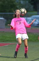 Wolcott High School's Brooke Tracey knocks the ball down during the girls varsity soccer game in Wolcott against Seymour High School on Thursday. Emily J. Reynolds. Republican-American
