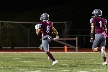 Naugatuck's Elijah Robinson #6 returns the 2nd half kickoff and runs down the field 80 yards for a touchdown during a NVL Football game Between Oxford and Naugatuck at Naugatuck High School in Naugatuck on Friday. Bill Shettle Republican-American