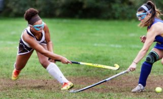 #12 Kaya Johnson of Thomaston blasts a ball past #5 Hannah Grieco of Brookfield during field hockey action in Thomaston Monday. Steven Valenti Republican-American
