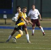 Kennedy High School's Brian Portela tries to control the ball in front of Sacred Heart High School's Matthew Francisco during the boys varsity soccer game in Waterbury on Tuesday. Emily J. Reynolds. Republican-American