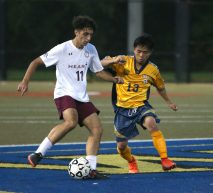 Sacred Heart High School's Gabriel Melo battles Kennedy High School's Sher Htoo for the ball during the boys varsity soccer game in Waterbury on Tuesday. Emily J. Reynolds. Republican-American