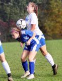 #15 Dani Forte of Nonnewaug controls a ball over #16 Ella Demers of Litchfield during soccer action in Litchfield Tuesday. Steven Valenti Republican-American