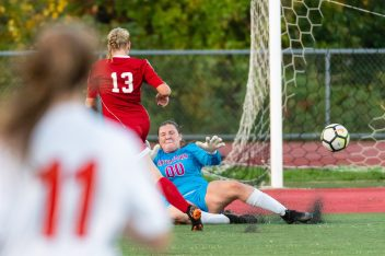 Wolcott's Tiona Watts #13 kicks the ball by Watertown's goalkeeper Emily Detula #00 for the first goal of the game during a Girls NVL Soccer game between Watertown and Wolcott at Wolcott High School in Wolcott on Wednesday. Bill Shettle Republican-American