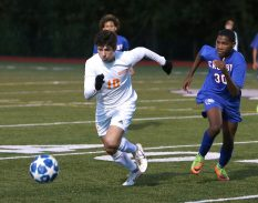 Watertown High School's Moni Jusufi races Crosby High School's Tyson Parker for the ball during the boys varsity soccer game in Waterbury on Tuesday. Emily J. Reynolds. Republican-American