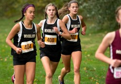 Woodland's Jaden Young, Chloe Poulos and Emma Slavin run together during the NVL Cross Country championships held Wednesday at Veterans Memorial Park in Watertown. Woodland went on to win the meet. Jim Shannon Republican American