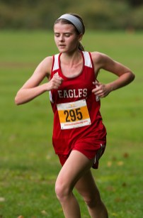 Wolcott's Kathryn Rodrigues makes her way through the course during the NVL Cross Country championships held Wednesday at Veterans Memorial Park in Watertown. Jim Shannon Republican American