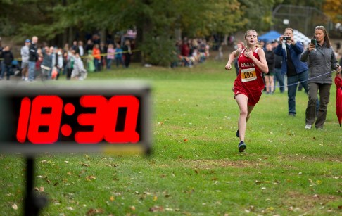 Wolcott's Kathryn Rodrigues makes her way to the finish line to take the top spot during the NVL Cross Country championships held Wednesday at Veterans Memorial Park in Watertown. Kathryn Rodrigues finished with a time of 18:32:74. Jim Shannon Republican American