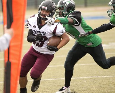 Torrington's Alex Gillotte (29) gets knocked out of bounds by Wilby's Dylon Alleyne-Mckitty (4) during their NVL game Saturday morning at Municipal Stadium in Waterbury. Jim Shannon Republican American