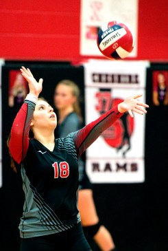 Cheshire's Michelle Frenkel (18) served the ball during their volleyball match with Sheehan Tuesday at Cheshire High School. Jim Shannon Republican American
