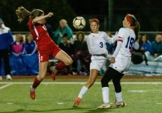 Cheshire's Lila McNamee #2 controls the ball in front of Old Lyme players Grace Lathrop #3 and Caroline Wallace #18 during a Girls SCC Soccer game between Old Lyme and Cheshire at Cheshire High School in Cheshire on Wednesday. Bill Shettle Republican-American