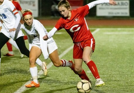 Cheshire's Caroline Campion #10 rushes into the zone with ball with Old Lyme's Danielle McCarthy #2 defending during a Girls SCC Soccer game between Old Lyme and Cheshire at Cheshire High School in Cheshire on Wednesday. Bill Shettle Republican-American