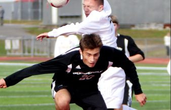 #3 Adam Ortiz of Joel Barlow and #20 Matt Karp of Pomperaug High head a ball near the Barlow goal during Soccer action in Southbury Friday. Steven Valenti Republican-American