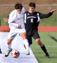 #9 Pablo Correa-Ramirez of Joel Barlow and #6 Chris Moreira of Pomperaug High battle for the ball during Soccer action in Southbury Friday. Steven Valenti Republican-American