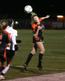 Watertown High School's Madeline Daigneault heads the ball during the NVL Girls' Soccer Tournament semi-final girls varsity soccer game in Watertown against Woodland Regional High School on Tuesday. Emily J. Reynolds. Republican-American