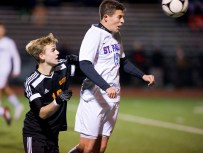 St. Paul's Patrick Carbone (19) heads the ball in front of Watertown's Jake Champagne (18) during their NVL boys soccer semi-final game Tuesday at Crosby High School. Jim Shannon Republican American