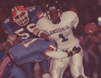 1998: Jarvis Benjamin gets hit by Bloomfield #71 Mark Roberts during their game in West Haven on Saturday. (RA)