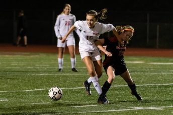Wolcott's Michaela Vaughn #16 tries to hold off Watertown's Morgan Dodge #11 during the girls NVL Championship game between Watertown and Wolcott at Naugatuck High School in Naugatuck on Thursday. Bill Shettle Republican-American
