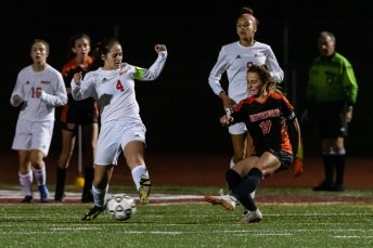 Watertown's Meadow Mancini #10 takes a shot on goal with Wolcott's Bella Piacentini #4 defending during the girls NVL Championship game between Watertown and Wolcott at Naugatuck High School in Naugatuck on Thursday. Bill Shettle Republican-American