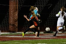 Watertown's Meadow Mancini #10 scores a goal while colliding with Wolcott's goalkeeper Allie Gough during the girls NVL Championship game between Watertown and Wolcott at Naugatuck High School in Naugatuck on Thursday. Bill Shettle Republican-American