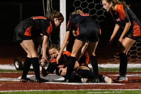 Waterown's Meadow Mancini #10 lays on the ground surrounded by her teammates after scoring a goal and colliding with the Wolcott goalkeeper during the girls NVL Championship game between Watertown and Wolcott at Naugatuck High School in Naugatuck on Thursday. Bill Shettle Republican-American