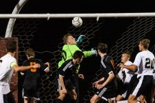 Watertown goalkeeper Hayden Beauty #00, center, makes a save amongst many bodies in front of him during the boys NVL Championship game between Watertown and Woodland Regional at Naugatuck High School in Naugatuck on Thursday. Bill Shettle Republican-American