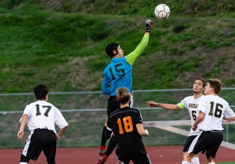 Woodland goalkeeper Ryan Lamb #15 punches the ball out the box area on a corner kick during the boys NVL Championship game between Watertown and Woodland Regional at Naugatuck High School in Naugatuck on Thursday. Bill Shettle Republican-American