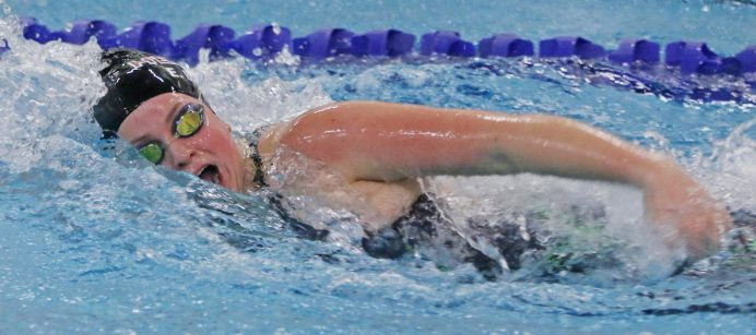 Sacred Heart's Elizabeth Brown won the 100 yard Freestyle during the NVL finals at Kennedy High School Friday night. Brown had a time of 00:56.67. Seymour won the NVL title with an overall score of 755.5. Michael Kabelka / Republican-American
