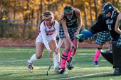 Cheshire's Kiley Jackson #16 and Guilford's Emily Torre #13 battle for the ball in front of Guilford goalkeeper Eve Young #91 during the SCC Championship game between Cheshire and Guilford at Guilford High School in Guilford on Saturday. Guilford scored two unanswered goals, after Cheshire tied it up to win 3-1, winning the SCC Title. Bill Shettle Republican-American