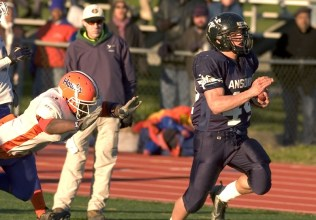 2006: Ansonia's Alex Thomas outruns a Bloomfield defender on his way for a 44-yard touchdown run during their 34-12 win in the Class S finals Saturday at Jess Dow Field on the SCSU campus in New Haven. Thomas finished with 257 yards and three touchdowns. (RA)
