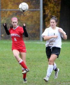 #8 Emily Whalen of Northwestern controls a ball as from #1 Karly Laliberte of Woodland defends during CIAC Class M girls soccer tournament action in Winsted Monday. Steven Valenti Republican-American
