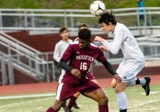 Newtown's Duncan O'Leary #13 heads the ball in front of Naugatuck's Christopher Akinduro #16 during the first round of the CIAC Class LL boys' soccer tournament between #22 Newtown and #11 Naugatuck at Naugatuck High School in Naugatuck on Tuesday. Naugatuck beat Newtown 1-0 and advances to the next round on Thursday. Bill Shettle Republican-American