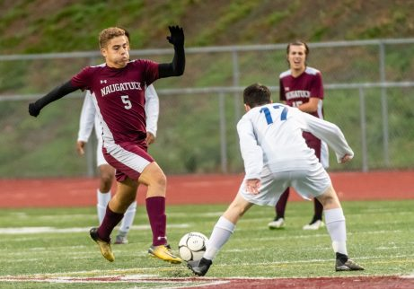 Naugatuck's Gustavo Medina #5 runs with the ball downfield against Newtown's Thomas Briscoe #17 defending during the first round of the CIAC Class LL boys' soccer tournament between #22 Newtown and #11 Naugatuck at Naugatuck High School in Naugatuck on Tuesday. Naugatuck beat Newtown 1-0 and advances to the next round on Thursday. Bill Shettle Republican-American