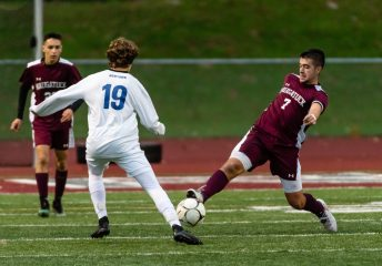 Naugatuck's Thomas Martins #7 gets to the ball in front of Newtown's Rudy Ryan #19 during the first round of the CIAC Class LL boys' soccer tournament between #22 Newtown and #11 Naugatuck at Naugatuck High School in Naugatuck on Tuesday. Naugatuck beat Newtown 1-0 and advances to the next round on Thursday. Bill Shettle Republican-American
