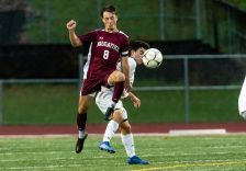 Naugatuck's Jake Corbo #8 gets to the ball in front of Newtown's Owen Baillargeon #10 during the first round of the CIAC Class LL boys' soccer tournament between #22 Newtown and #11 Naugatuck at Naugatuck High School in Naugatuck on Tuesday. Naugatuck beat Newtown 1-0 and advances to the next round on Thursday. Bill Shettle Republican-American