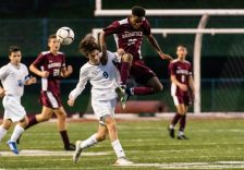 Naugatuck's Kareem Morris #23 and Newtown's Bryce Benson #9 battle trying to control the ball during the first round of the CIAC Class LL boys' soccer tournament between #22 Newtown and #11 Naugatuck at Naugatuck High School in Naugatuck on Tuesday. Naugatuck beat Newtown 1-0 and advances to the next round on Thursday. Bill Shettle Republican-American